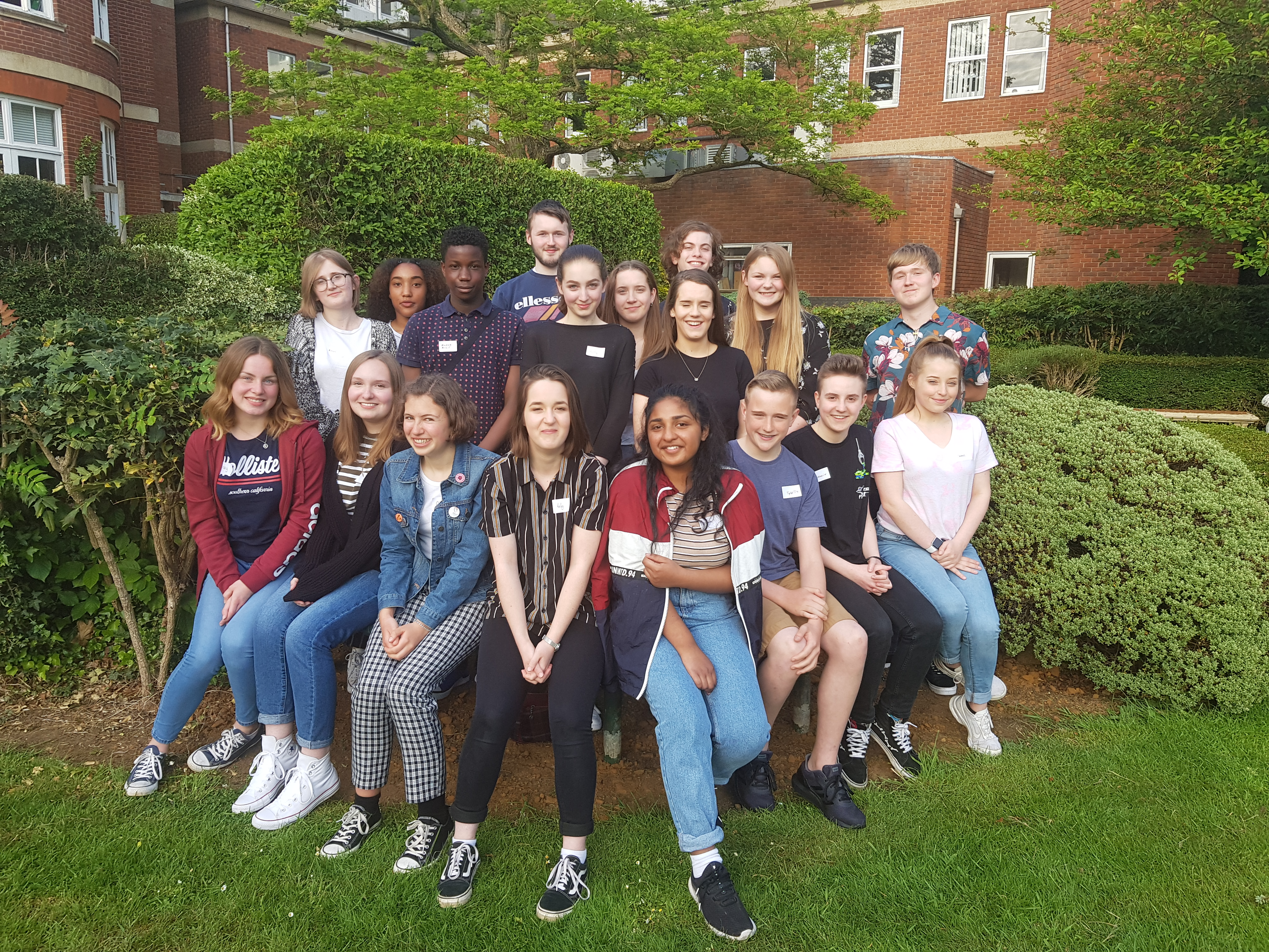 This is a picture of the young people who make up the Youth Commission. They are sitting in the garden at Wootton Hall when they held their first meeting