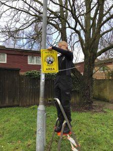 Northampton Borough Council Neighbourhood Warden installing the Neighbourhood Watch signs