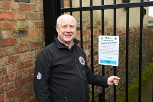 Stephen Mold pictured at one of the alleys that has been gated in Wellingborough