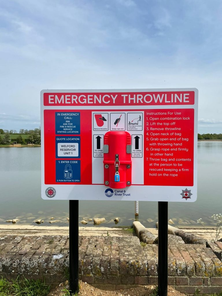 Welford Reservoir and in foreground is a red emergency throw line attached to an emergency board